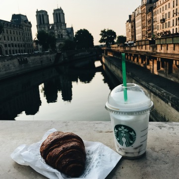 Starbucks and Croissant in Paris, France overlooking the Seine River