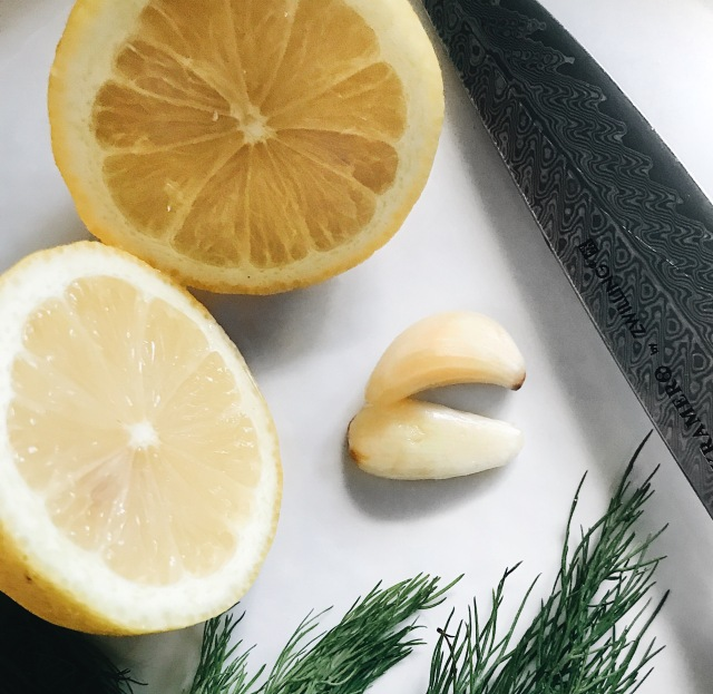 Lemon, dill and garlic on white