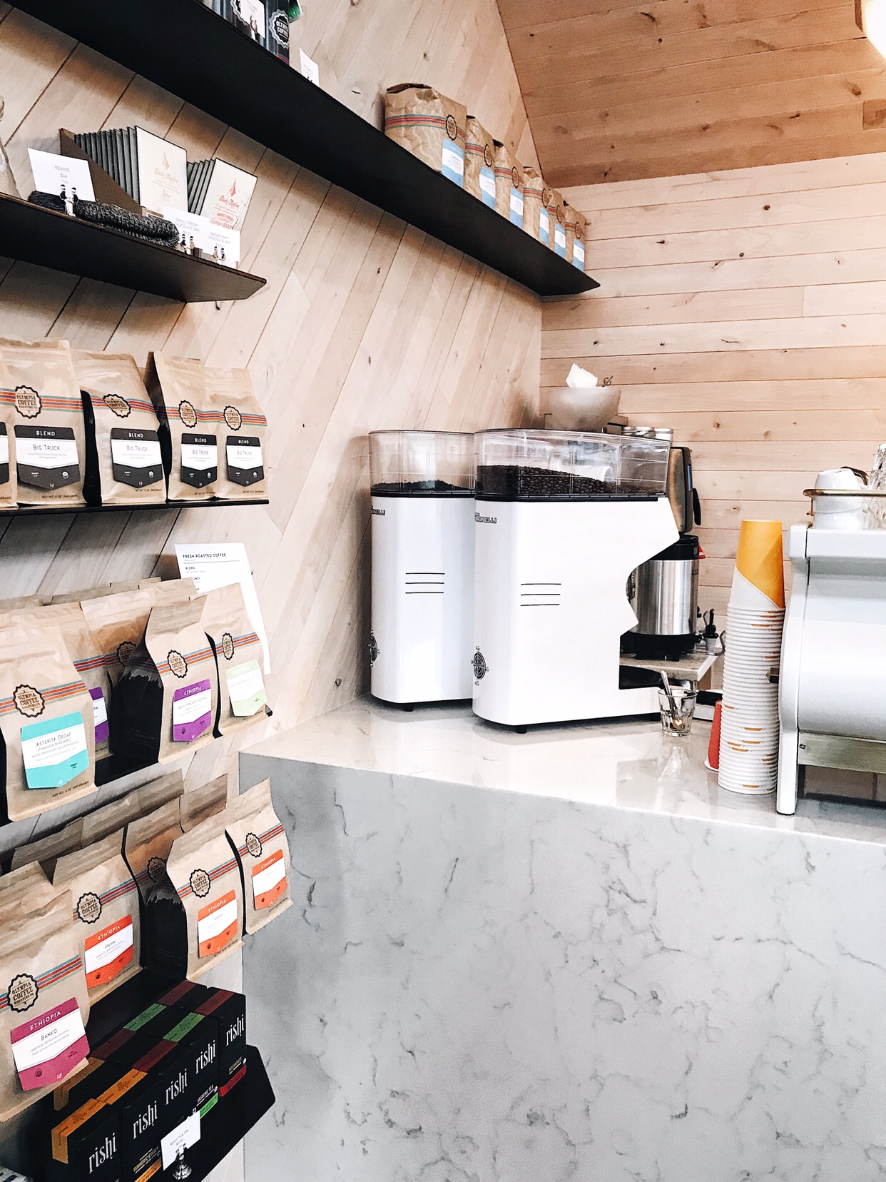 Olympia Coffee Roasters new cafe in West Seattle with marble countertops and sustainable wood siding | beccarisaluna.com
