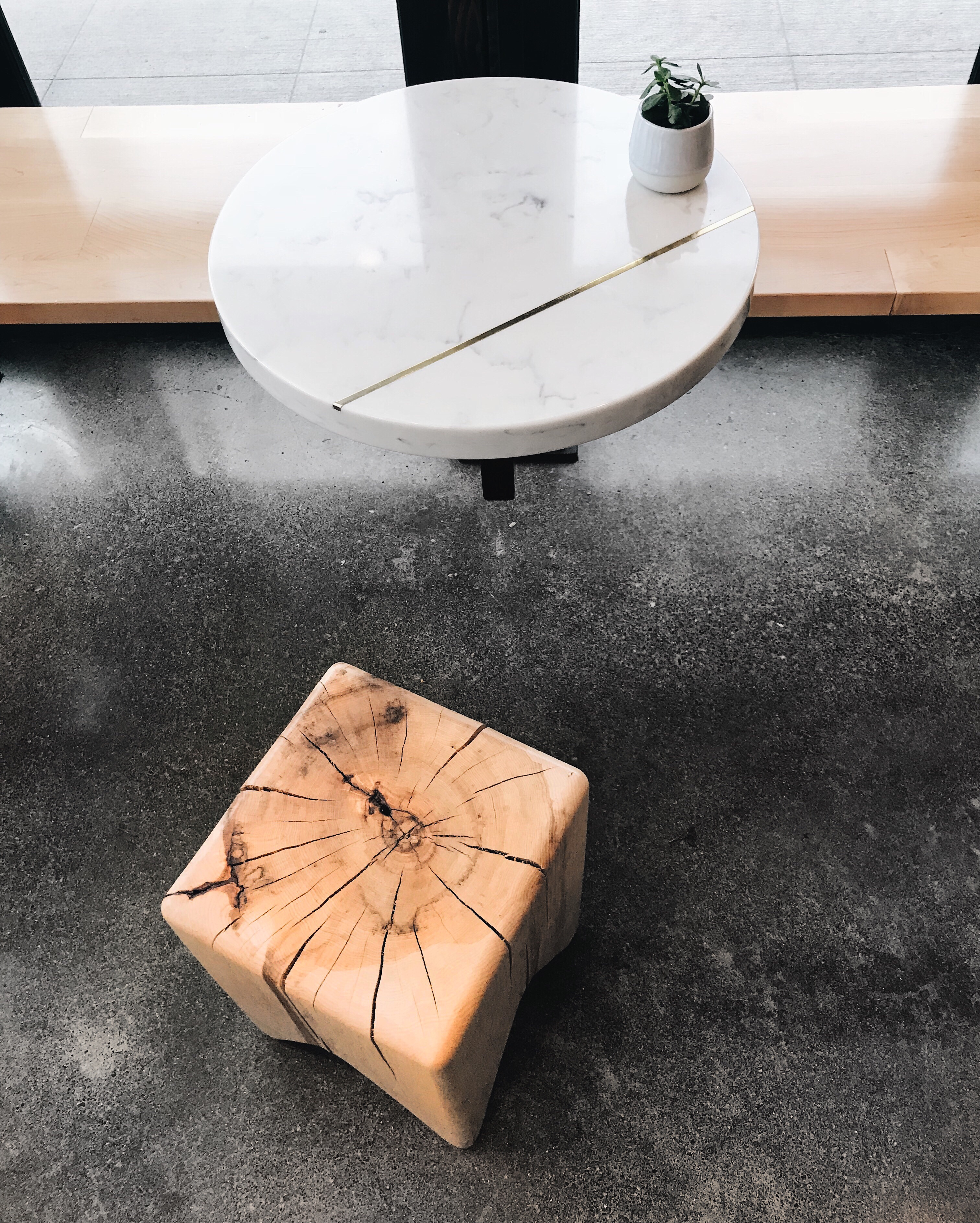 Custom quartz tables and wood stools at Olympia Coffee Roasters | beccarisaluna.com