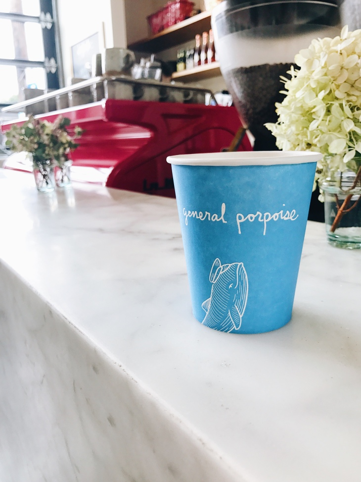 Blue to go coffee cup and hot pink La Marzocco espresso machine at General Porpoise | photo by Becca Risa Luna