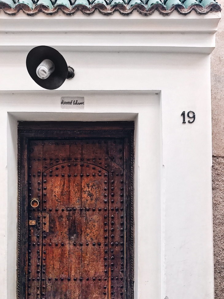 Door to Riad DixNeuf LaKsour Hotel in Marrakech | Review by travel writer Becca Risa Luna