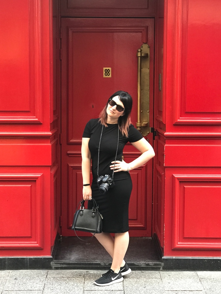 Becca Risa Luna style blogger against red wall